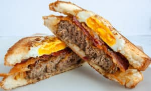 Brunch Patty Melt cut in half stacked on each other