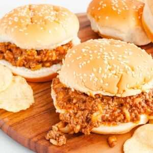 Assembled Sloppy Joes with Chicken Gumbo Soup on a wooden tray with potato chips