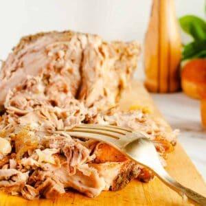 Shredded Porketta Roast on wooden cutting board